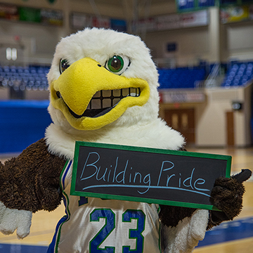 FGCU Eagle Holding Building Pride Sign