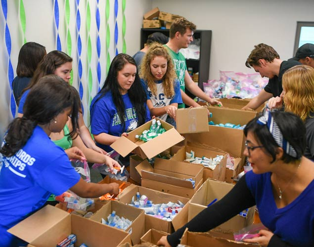 Photo os students assembling care kits after Hurricane Irma for community members.
