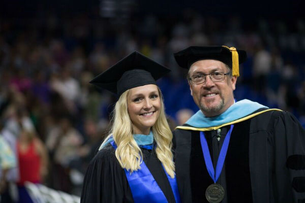 Recent MA Educational Leadership graduate Emily Chaikin (Assistant Director, Business Operations at FGCU) with Program Leader Dr. Thomas J. Roberts at graduation.